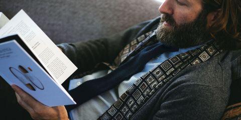 Finger, Facial hair, Beard, Collar, Cap, Moustache, Wrist, Nail, Publication, Reading,