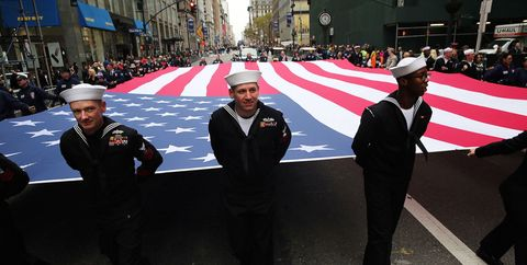 Hat, Uniform, Headgear, Flag, Costume accessory, Crew, Pedestrian, Official, Costume hat, Fedora,