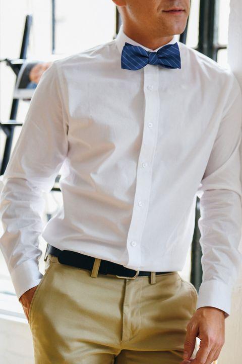 Clothing, Brown, Dress shirt, Collar, Sleeve, Trousers, Khaki, Shirt, Textile, White,