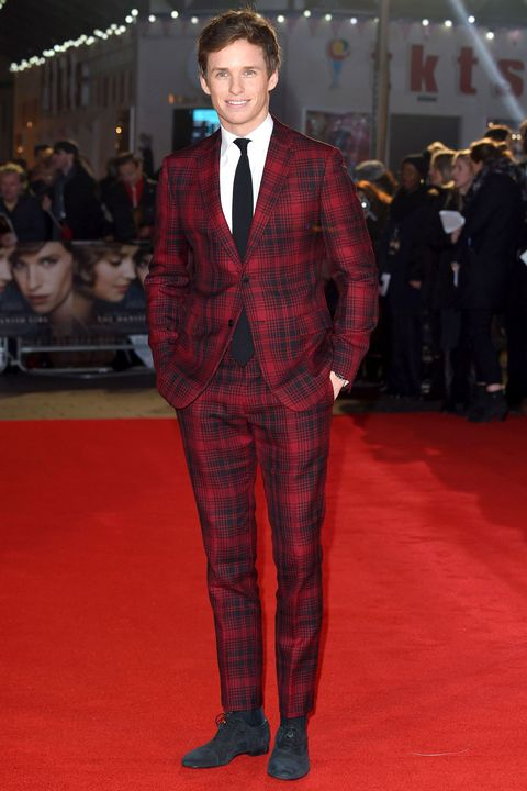<p>Eddie Redmayne provides a master class in nonboring formalwear—blue tuxedos and suits in every jewel tone—but he keeps his shirts, ties, and shoes simple. If one thing shouts, everything else should whisper.  </p>