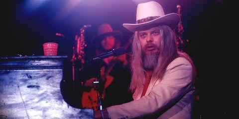 Hat, Facial hair, Musician, Music artist, Beard, Moustache, Artist, Headgear, Musical instrument, Sun hat,