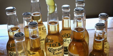Liquid, Product, Bottle, Fluid, Glass bottle, Logo, Alcohol, Drinkware, Barware, Bottle cap,