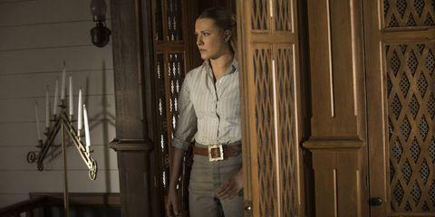 Jeans, Denim, Dress shirt, Door, Waist, Home door, Iron, Belt, Door handle, Pocket,