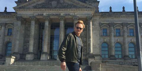 Architecture, Sunglasses, Denim, Jeans, Jacket, Landmark, Tourism, Street fashion, Travel, Classical architecture,