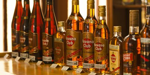 Bottle, Alcohol, Glass bottle, Alcoholic beverage, Drink, Liquid, Distilled beverage, Amber, Logo, Barware,