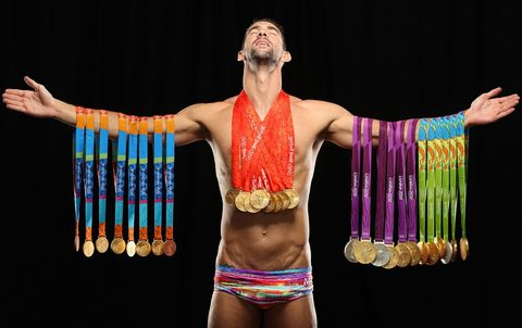 michael phelps poses with all his gold medals
