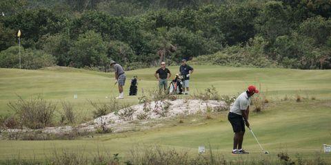 Sport venue, Human, Sports equipment, Recreation, Ball game, Golf course, Leisure, Standing, Golf club, Golfer,