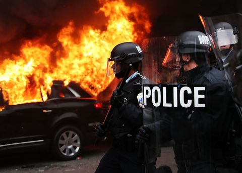 Human, Event, Helmet, Emergency service, Pollution, Police, Fire, Personal protective equipment, Law enforcement, Flame,