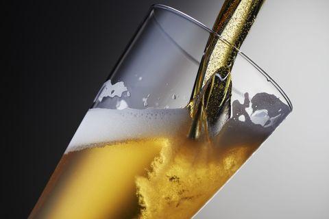 Fluid, Liquid, Drink, Yellow, Alcoholic beverage, Alcohol, Drinkware, Tableware, Distilled beverage, Glass,