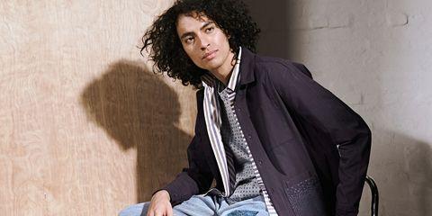 Hairstyle, Collar, Dress shirt, Jheri curl, Style, Sitting, Black hair, Blazer, Jacket, Ringlet,