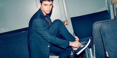 Sitting, Blazer, Suit trousers, Black hair, Employment, Lap, Pocket, Cuff, Armrest, Model,