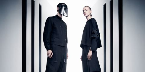 Black, Clothing, Fashion, Standing, Formal wear, Outerwear, Black-and-white, Fashion design, Suit, Photography,