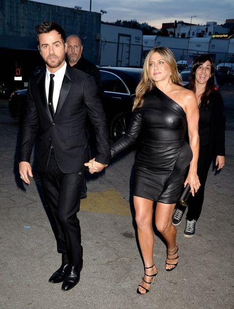 Little black dress, Clothing, Suit, Dress, Event, Formal wear, Cocktail dress, Leg, Luxury vehicle, Tuxedo,