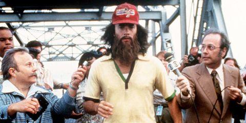 Cap, Facial hair, Microphone, Beard, Moustache, Baseball cap, Tie, Thumb, Cricket cap, Beanie,