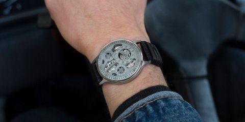 Finger, Wrist, Joint, Black, Analog watch, Denim, Metal, Watch accessory, Watch, Symbol,