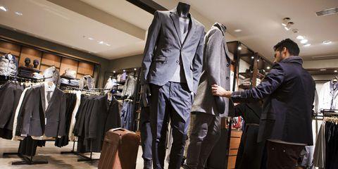Collar, Dress shirt, Coat, Retail, Formal wear, Clothes hanger, Blazer, Fashion, Jacket, Suit trousers,