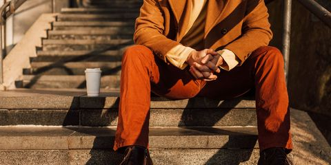 Sitting, Stairs, Suit trousers, Orange, Knee, Street fashion, Pocket, Cuff,
