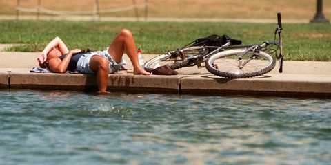 Vehicle, Water, Leisure, Recreation, Sun tanning, Bicycle, Endurance sports, Bicycle accessory, Cycling,