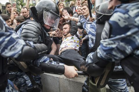 Police detain a protester in Moscow, Russia.