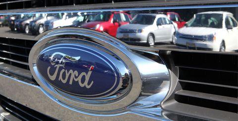 Motor vehicle, Vehicle, Automotive design, Automotive parking light, Automotive lighting, Car, Automotive exterior, Logo, Grille, Hood,