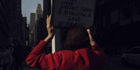 People, Red, Protest, Text, Public event, Human, Font, Demonstration, Hand, Metropolitan area,