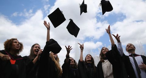 Academic dress, Graduation, People, Mortarboard, Event, Public event, Crowd, Cheering, Headgear, Demonstration,