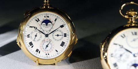 Product, Yellow, Analog watch, Watch, Photograph, Glass, Font, Still life photography, Metal, Fashion,