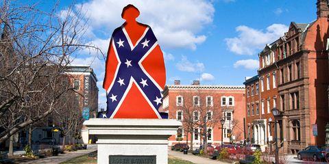 Landmark, Statue, Monument, Architecture, Flag, Building, Real estate, City, Sculpture, Sign,