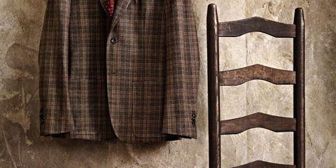 Collar, Sleeve, Dress shirt, Textile, Clothes hanger, Pattern, Fashion design, Button, Vintage clothing, Costume design,