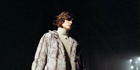 Darkness, Street fashion, Acting, Fur, Overcoat, Fur clothing,
