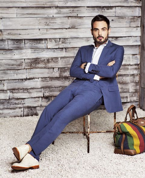Clothing, Dress shirt, Collar, Outerwear, Sitting, Style, Beard, Formal wear, Bag, Blazer,