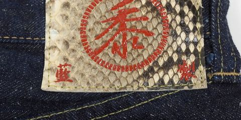 Textile, Denim, Label, Stitch, Pocket, Symbol, Embroidery, Needlework, Wallet, Thread,