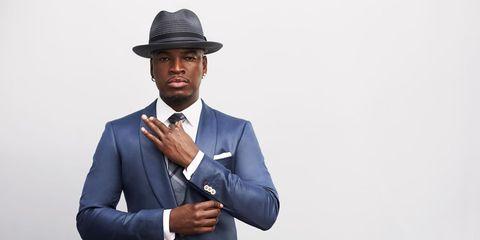Hat, Finger, Coat, Dress shirt, Collar, Sleeve, Shoulder, Shirt, Joint, Outerwear,