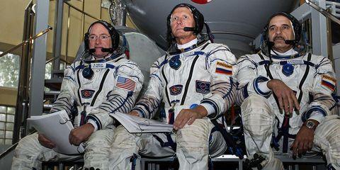 Astronaut, Space, Uniform, Personal protective equipment, Team, Aerospace engineering, Crew, Sports jersey, Glove,