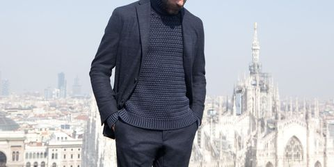 Sleeve, Facial hair, Standing, City, Urban area, Beard, Landmark, Dress shirt, Metropolis, Metropolitan area,