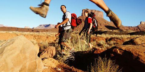 Human leg, People in nature, Outdoor recreation, Shorts, Rock, Adventure, Geology, Bedrock, Badlands, Knee,