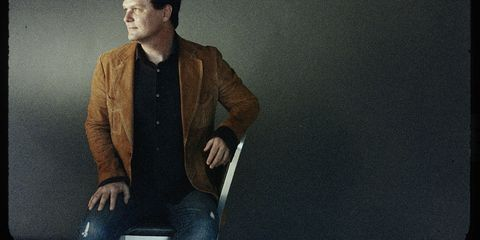 Coat, Collar, Sitting, Blazer, Denim, Suit trousers, Flash photography, White-collar worker, Pocket, Cuff,