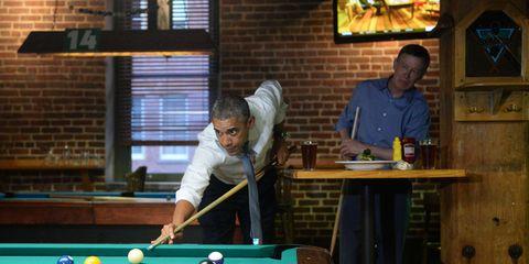 Billiard ball, Pool player, Indoor games and sports, Wood, Ball, Pool, Billiard table, Cue stick, Recreation room, Lighting,