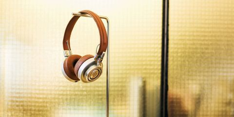 Audio accessory, Gadget, Spiral, Still life photography, Communication Device, Circle, Telephony, Plywood, Peripheral, Transparent material,