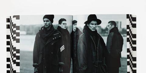 Sleeve, Hat, Headgear, Overcoat, Street fashion, Costume, Black-and-white, Fedora, Costume accessory, Frock coat,