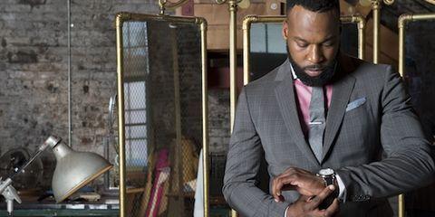 Outerwear, Coat, Dress shirt, Suit, Formal wear, Blazer, Watch, Suit trousers, Pocket, Tuxedo,