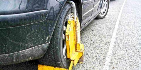 Tire, Wheel, Automotive tire, Yellow, Automotive design, Rim, Alloy wheel, Road surface, Automotive wheel system, Automotive exterior,