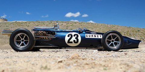Tire, Automotive tire, Automotive design, Blue, Automotive wheel system, Photograph, Car, Open-wheel car, Rim, Logo,
