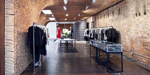 Ceiling, Arch, Clothes hanger, Brick, Outlet store, Aisle,
