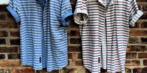 Blue, Collar, Sleeve, Dress shirt, Textile, Pattern, Brick, Wall, Baby & toddler clothing, Clothes hanger,