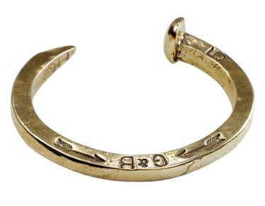 Jewellery, Metal, Fashion accessory, Fashion, Body jewelry, Natural material, Circle, Silver, Mineral, Platinum,