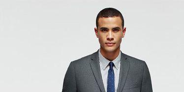 Dress shirt, Collar, Sleeve, Standing, Suit trousers, Joint, Formal wear, Pocket, Blazer, White-collar worker,