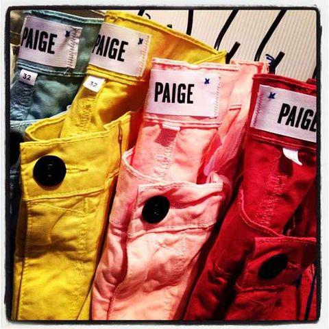 Yellow, Textile, Pattern, Material property, Peach, Button, Fashion design, Label,