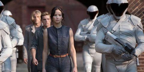 Denim, Standing, Helmet, Waist, Street fashion, Ballistic vest, Belt, Air gun, Abdomen, Pocket,