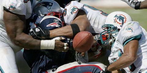Football helmet, Sports uniform, Sports gear, Sportswear, Football equipment, Ball, Football gear, Team sport, Jersey, Sports equipment,